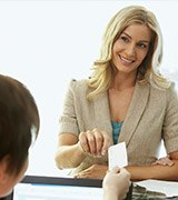 Smiling woman checkingin at front desk