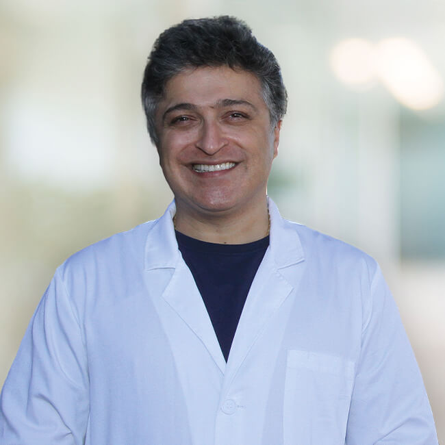 Dr. Azmoodeh  smiling
