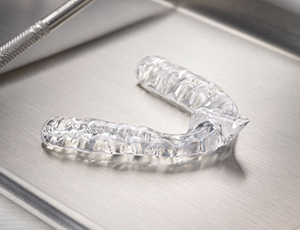 Clear mouthguard on metal tray