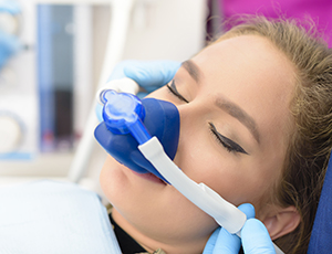 Woman in dental chair with nitrous oxide nasal mask