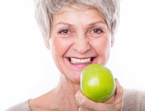 senior woman smiling apple