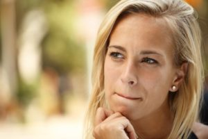 woman hand on chin thinking